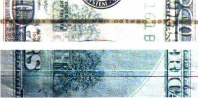 Рис. 23. Имитация нити с наклейкой бумажной полоски: а — на просвет; б — в УФЛ.